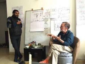 John Buck in conversation with a workshop participant in India, Spring 2016.