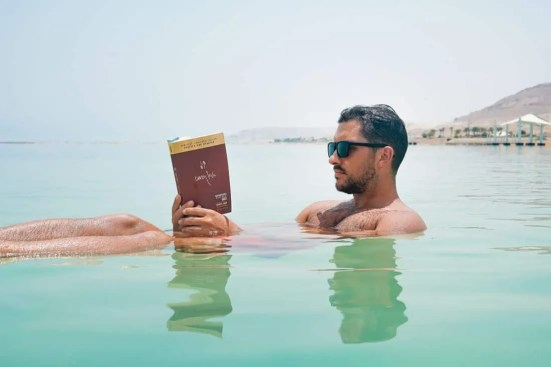 Bring a physical book to the beach instead of your phone so you are not tempted to check your social networks