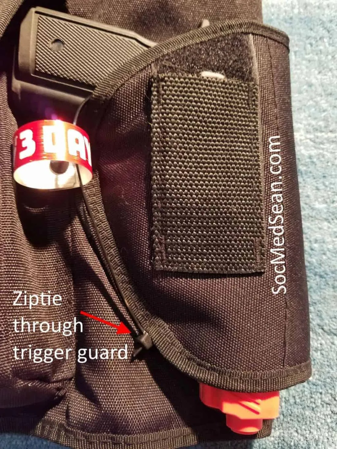 This rubber training pistol was zip-tied into the holster