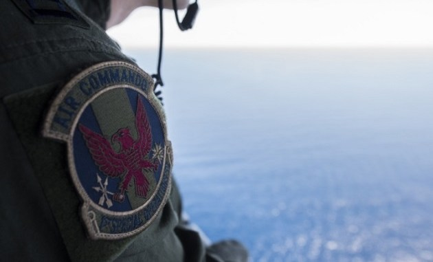 1st SOS crew member looks out over the crash site of STRAY 59 - a MC-130E that crashed 37 years ago. (photo SSgt Matthew Fredericks, 18th Wing Public Affairs, Feb 26, 2018).