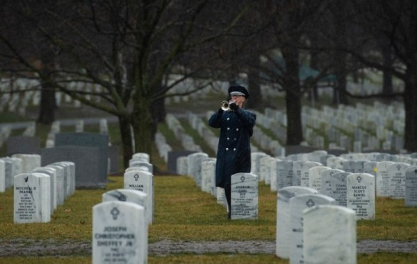 An Air Force bugler plays taps during the military funeral honors of Air Force Staff Sgt. Dylan Elchin, a Special Tactics combat controller assigned to the 26th Special Tactics Squadron, at Arlington National Cemetery, Va., Jan. 24, 2019. As a Special Tactics combat controller, Elchin was specially trained and equipped for immediate deployment into combat operations to conduct global access, precision strike, and personnel recovery operations. (U.S. Air Force photo by Senior Airman Joseph Pick)