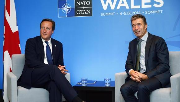 NATO chief, at summit, says Russia attacking Ukraine