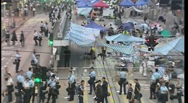 Hong Kong police clear barricades, open roads around protest site