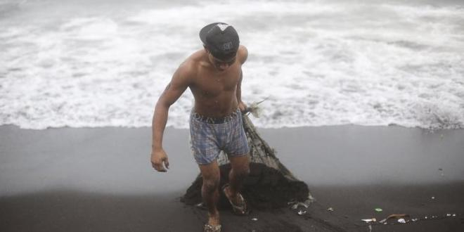 Philippines typhoon downgraded, but death toll rises to at least 22