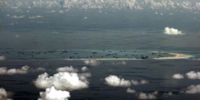 US warns China not to challenge military flights over South China Sea