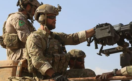Photos show U.S. commandos primed for fight in Syria