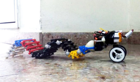 First wave-propelled robot swims, crawls and climbs using a single, small motor | ScienceDaily