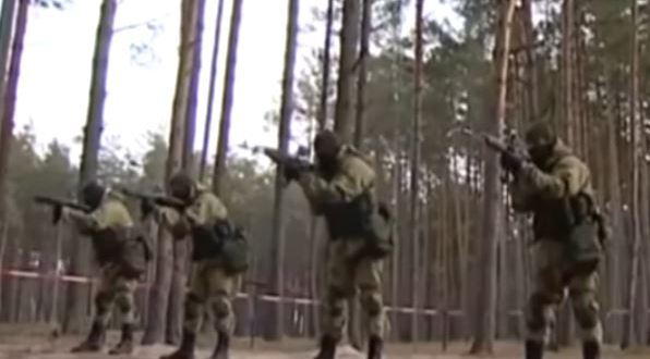 Chilling footage of 200 masked Russian special forces troops preparing for war | Mirror Online