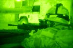 A night vision image of a soldier from the Duke of Wellington's Regiment taking up a fire position ready to start Operations Gray Wolf near Sharkarta, Iraq in 2005.