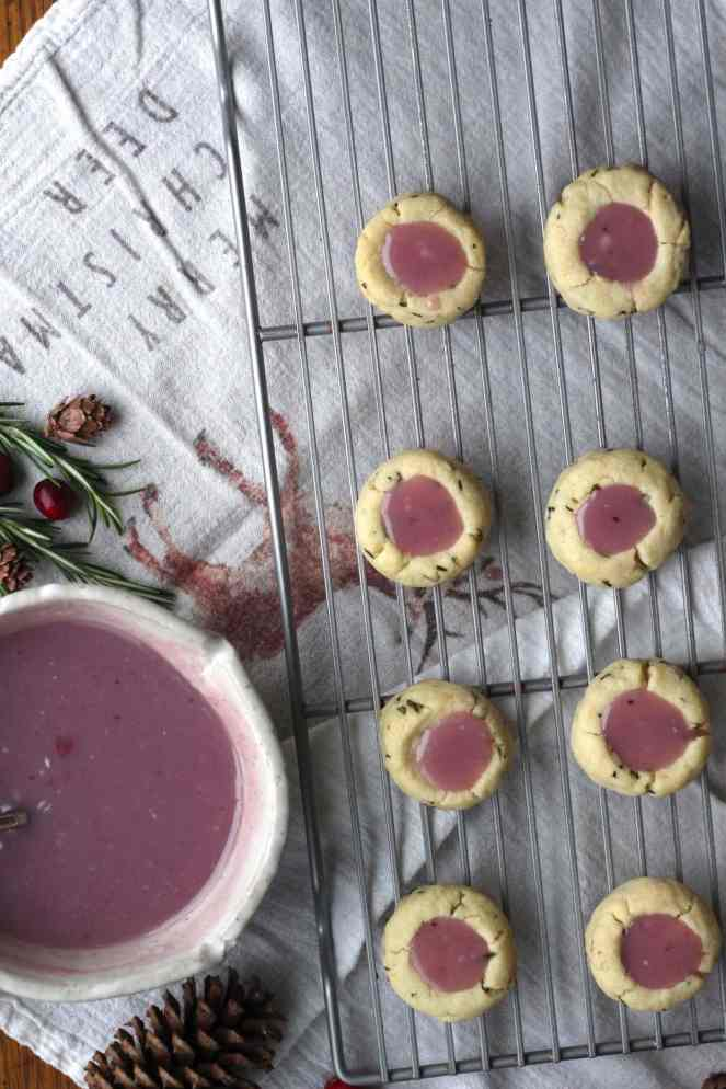 These Rosemary Shortbread Cookies with White Chocolate Cranberry Ganache are the perfect mix between sweet and savory. The Rosemary Shortbread dough is simple to put together, requiring minimal ingredients. It's slightly sweet, a little salty, and packed with delicious rosemary. The White Chocolate Cranberry Ganache is absolutely decadent, highlighting the festive seasonal berry. | #SoHappyYouLikedIt