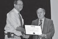 IEEE Division I Director, Cor Claeys (right) of imec, honoring Dr. Jean-Pierre Colinge (left) of TSMC for receiving  the 2012 Andrew S. Grove Award for his contributions to SOI. The presentation was made during the 2012 ESSDERC meeting in Bordeaux, France. (Photo Credit: Yann Deval, ESSDERC-ESSCIRC Conference Chair)