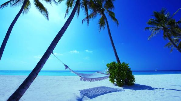 Standard wallpaper images of the whitest sands and bluest waters are most likely photographs taken in the Maldives