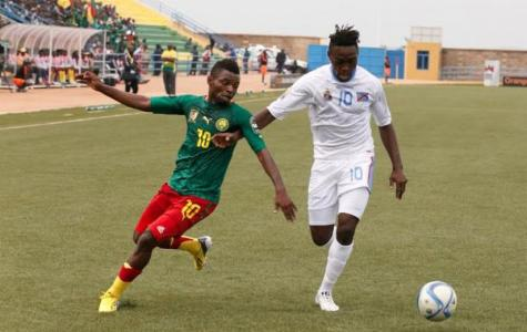 1453751320Cameroon's-Yazid-Atouba-vies-for-the-ball-against-DR-Congo's-Franck-Mfuki-during-the-final-Group-A-match-at-Huye-stadium