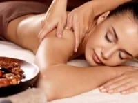 woman-on-a-massage-table-relaxed-getting-a-masage