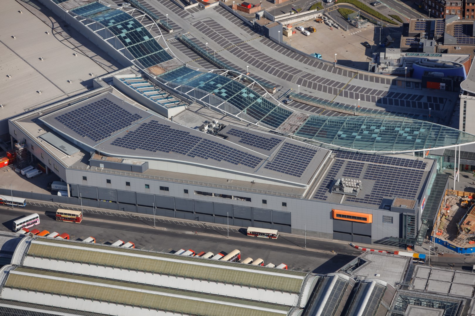 birds eye view of solar panels on shopping centre roof