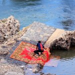 cleaning carpets in river
