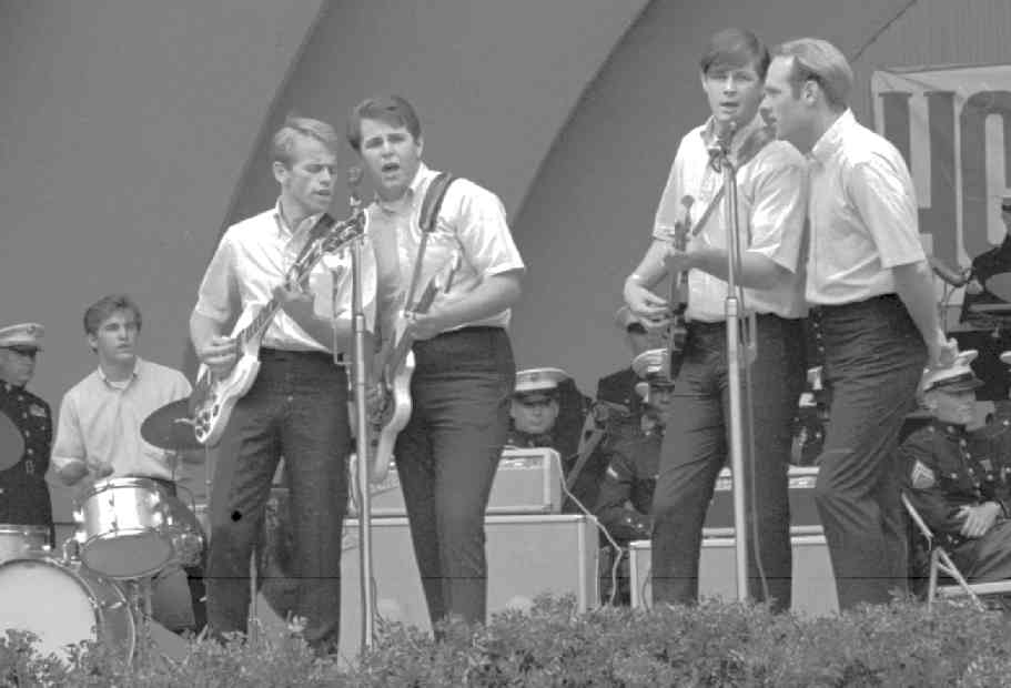 The Beach Boys in their early days with Dennis Wilson on the far left on the drums, Al Jardine, Carl Wilson, Brian Wilson and Mike Love.