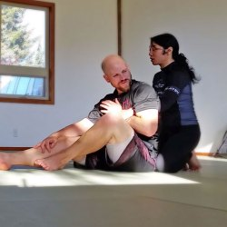 Jenn teaching back control at Solarte BJJ in Sequim, WA