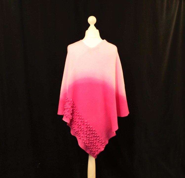 Solasonach Lambswool Ripples poncho in dip dyed pink