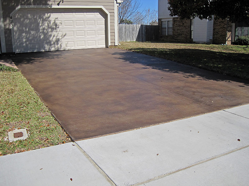 reverse angle view of brown acid stained driveway