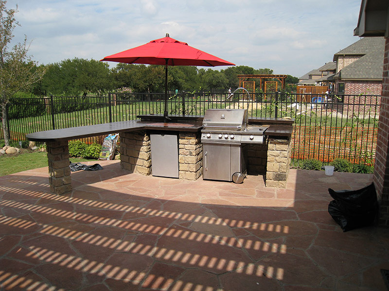 view of outside concrete countertop with a grill
