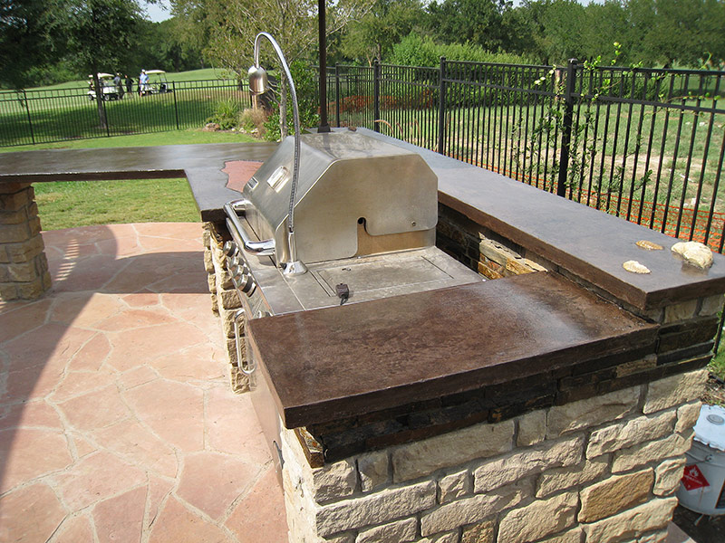 side view of concrete countertop with grill