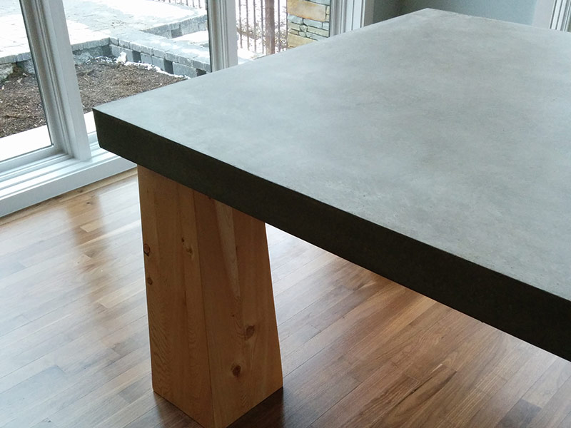 view of legs and edge of concrete table