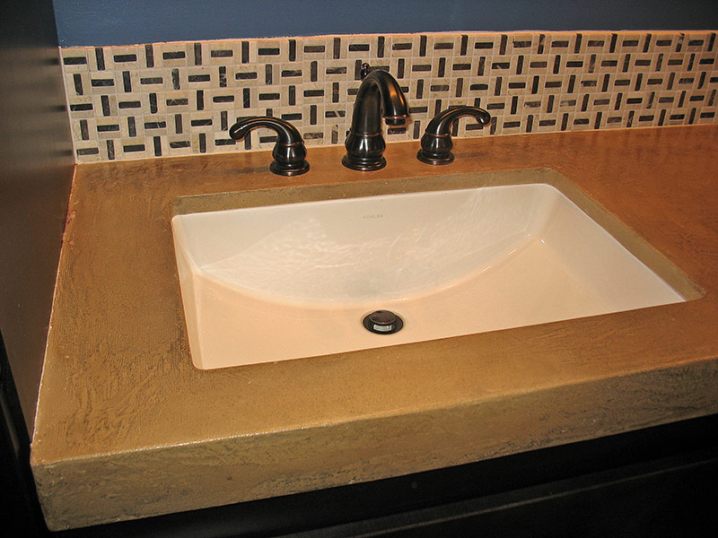 white porcelain undermount sink for installed in concrete countertop