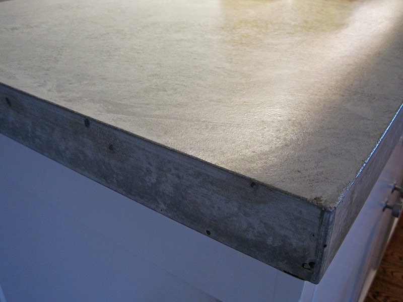 close up of gray concrete countertop edge