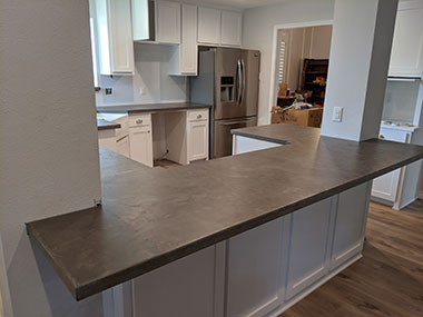 rear view of dark gray concrete countertops