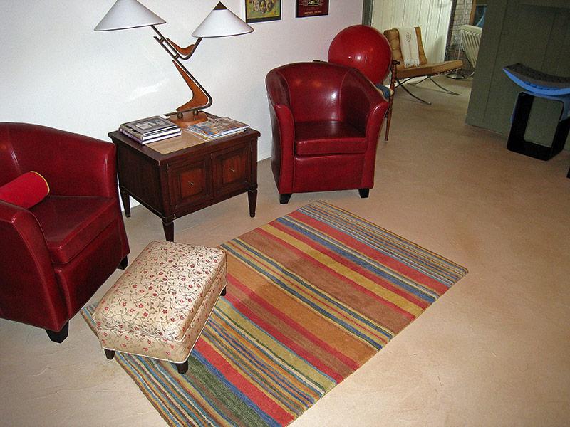rainbow colored rug on tan trowel down