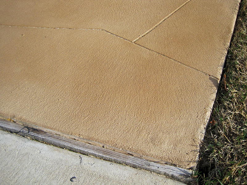 closeup of skim coat overlay on driveway