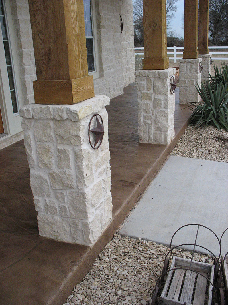 brown trowel down on front porch with stone columns