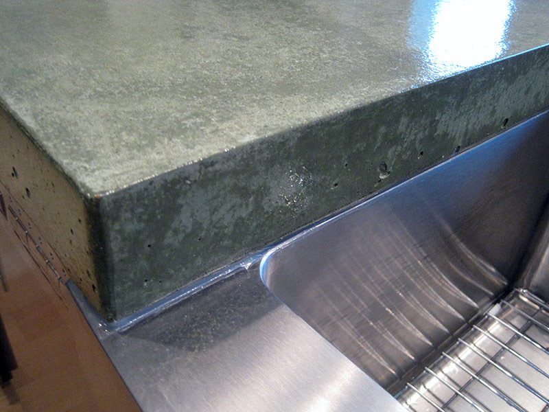 very close view of concrete countertop edge on undermount sink