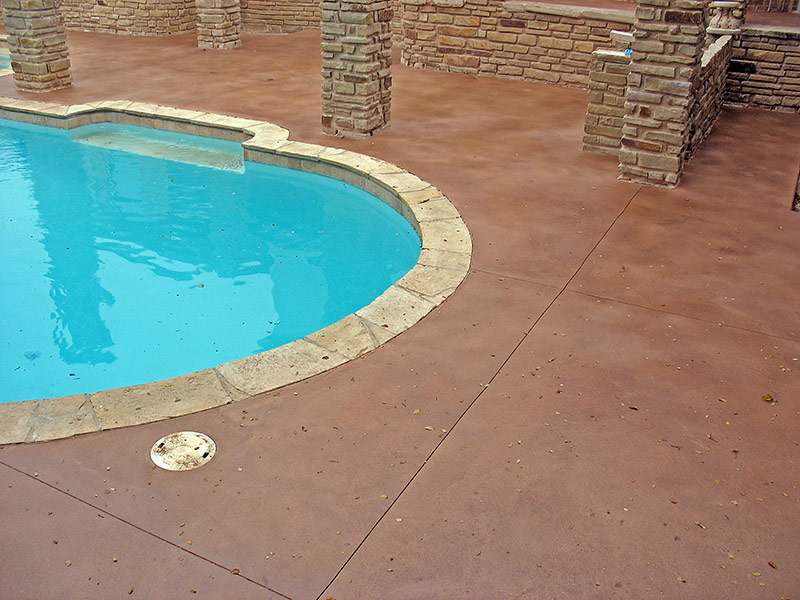 view of pool deck with stone columns