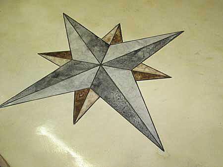 North Star scored into concrete floor