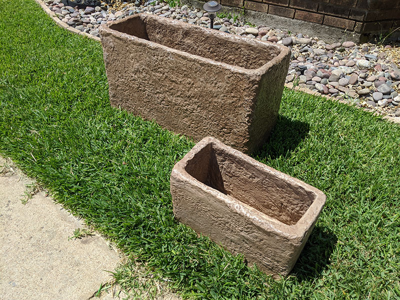 short rectangular concrete planters