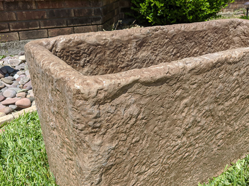 close up view of short rectangular concrete planter
