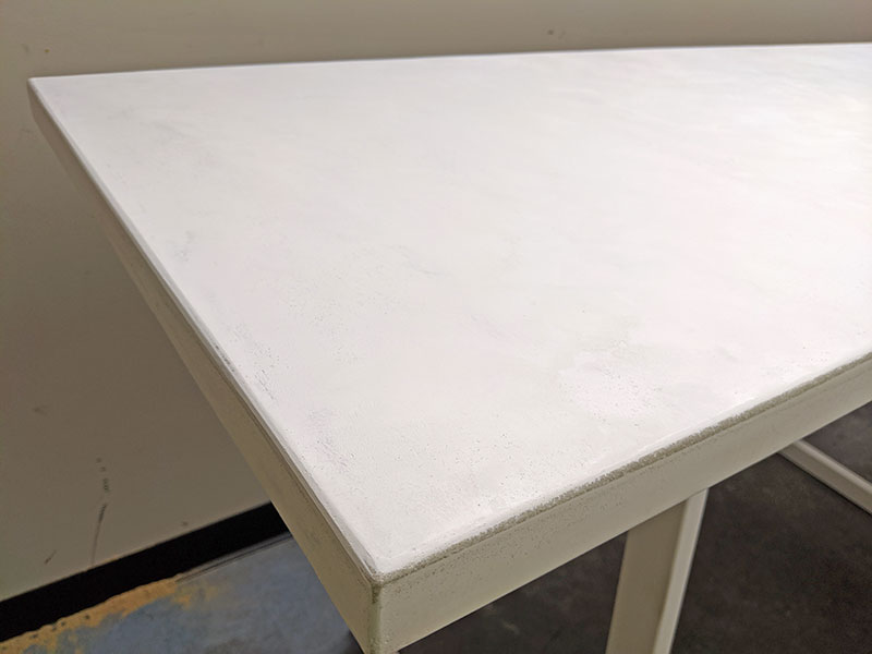 close up of white cement table top