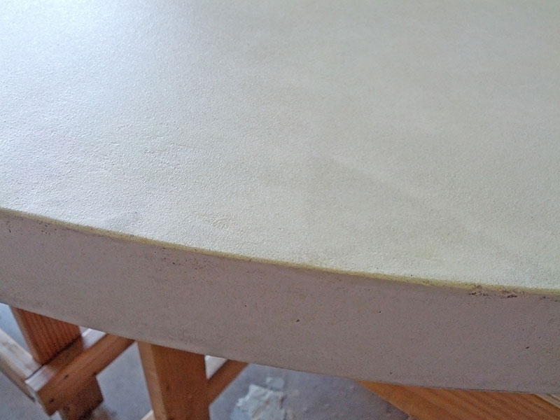 close up of round concrete table top edge