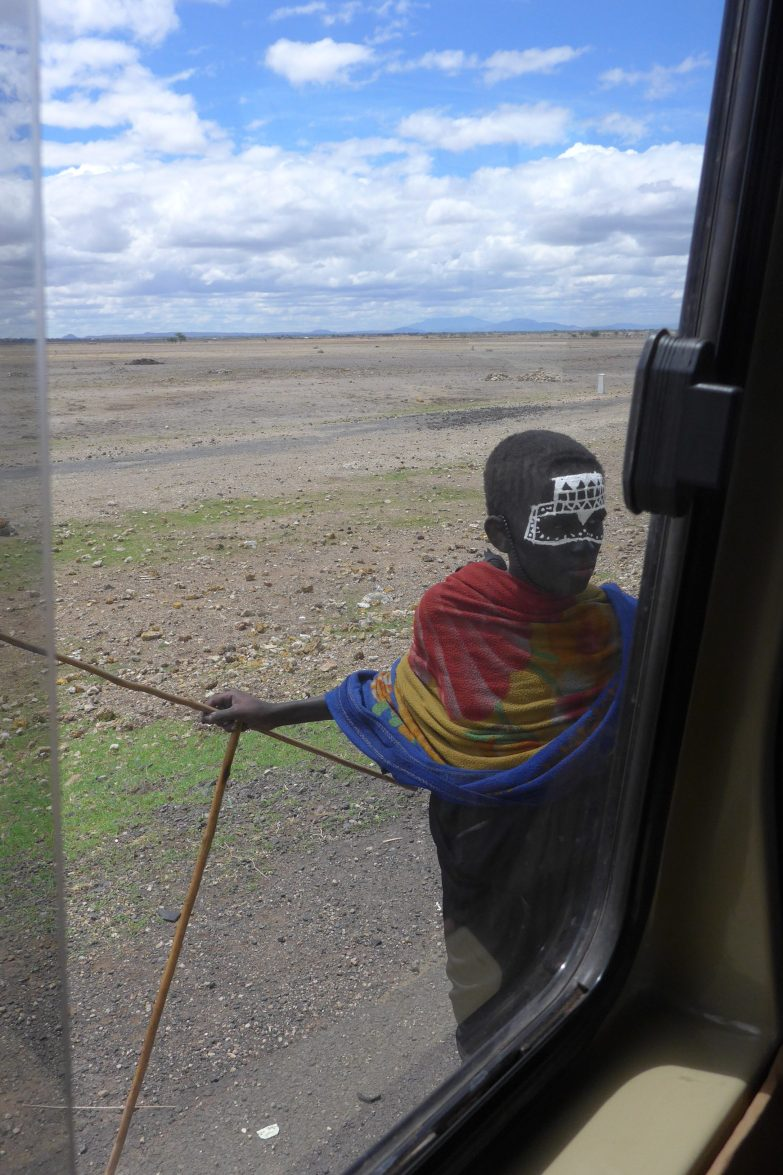 Maasai boy with painted face