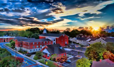 Solia Media is FAA Certified. Drone Shot of Rockdale County Government Buildings at sunset - Olde Town Conyers