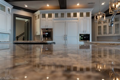 Preissless Design Interior Design - Lake Oconee property - kitchen counters - photography by Solia Media