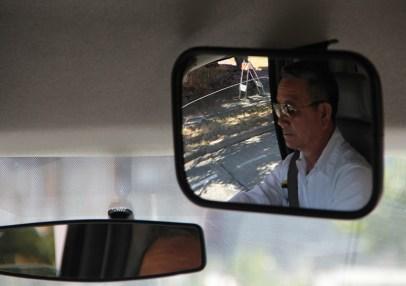 Circulator driver, Phuong Nguyen in rearview mirror (photo by Lara Breitkreutz)