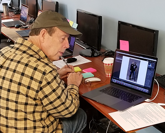 Eight volunteer photo editors readied 220 image files for print.