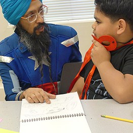 Vishavjit Singh coaches a comic book artist