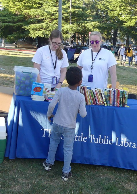 A mobile library customer chooses his book carefully.