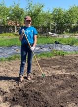 Taylor poses as she rakes