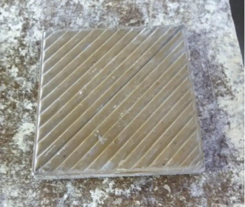 An original ceramic tile requiring replication