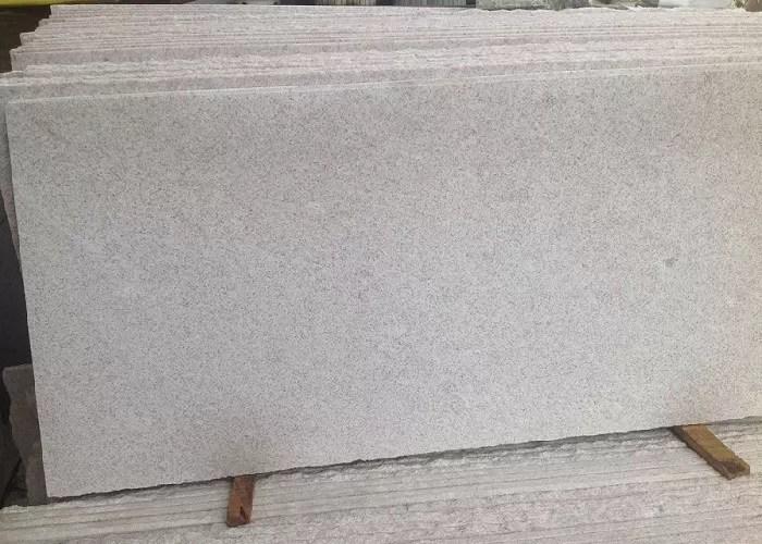 pearl white polished granite floor